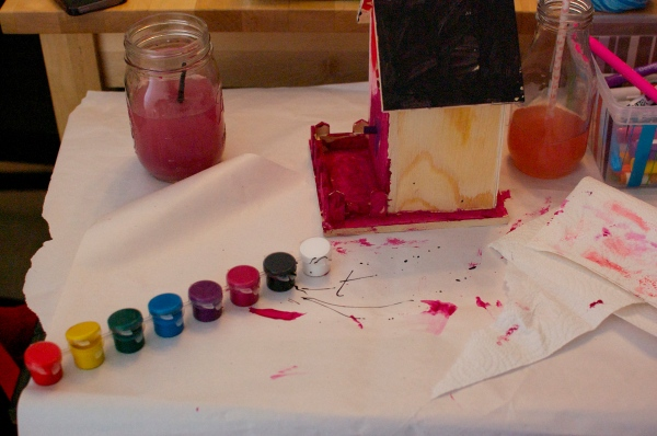 Paints and a birdhouse
