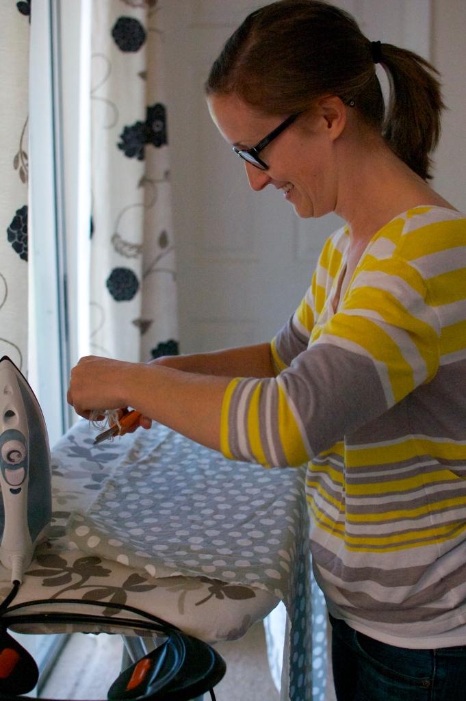 Woman ironing a skirt