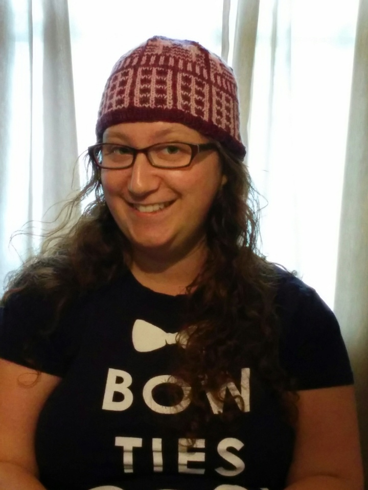 Whovian in a knitted Dalek hat