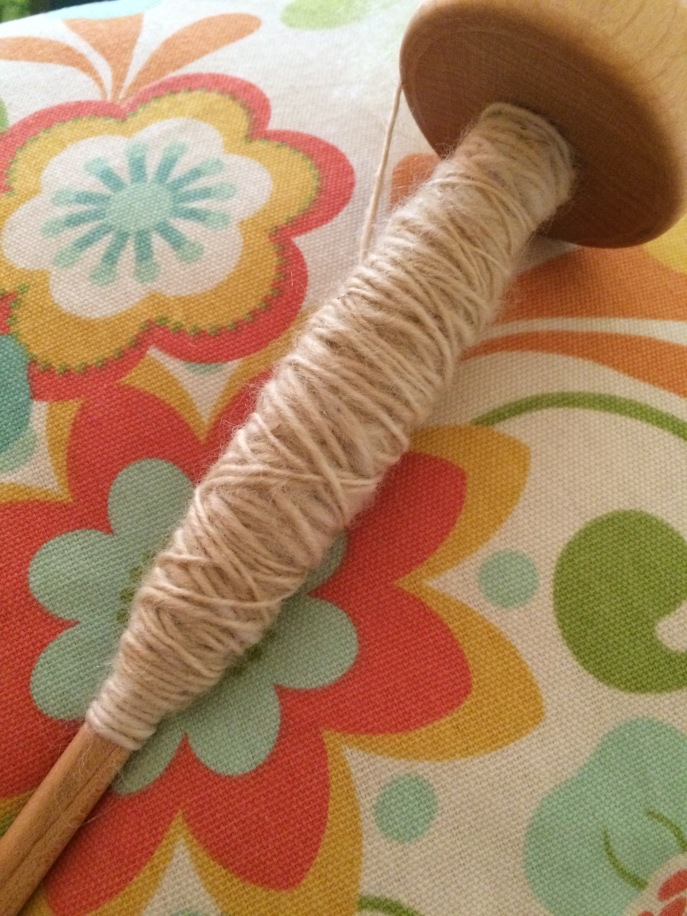 Yarn on a drop spindle