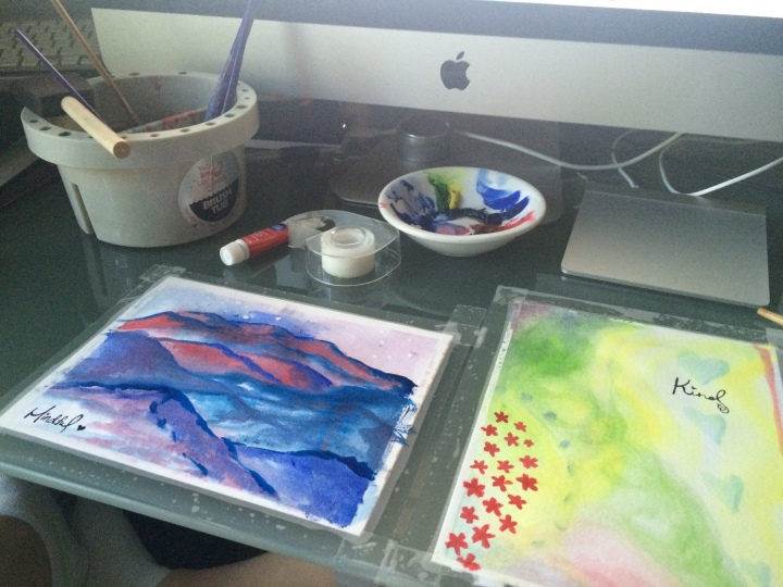 Watercolors on a desk